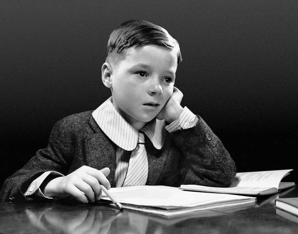 Child Poster featuring the photograph Boy Sitting At Desk W/book by George Marks