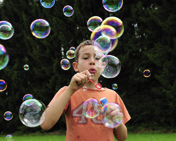 Bubbles Poster featuring the photograph Boy With Colorful Bubbles by Matthias Hauser