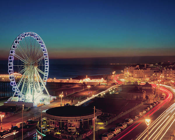 Horizontal Poster featuring the photograph Brighton Wheel And Seafront Lit Up At Night by PhotoMadly