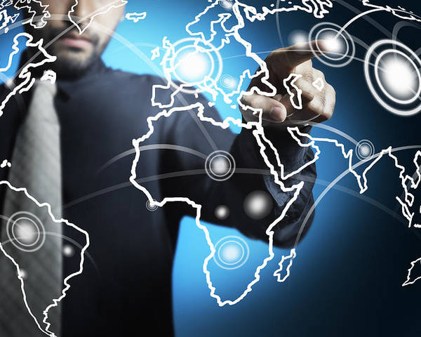 Business Poster featuring the photograph Businessman Touching World Map Screen by Setsiri Silapasuwanchai