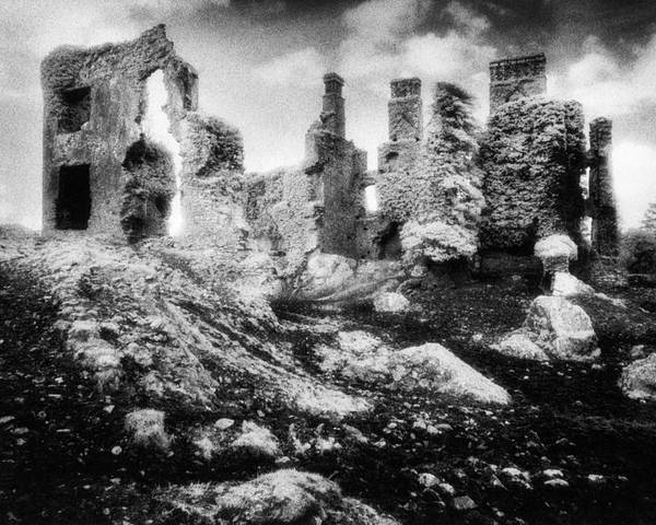 Ruins; Ruined; Remains; Abandoned; Chimneys; Stark; Glowing; Ethereal; Magical; Eerie; Mysterious; Mystery; Irish; Landscape; Architecture; Overgrown; Covered; Foliage Poster featuring the photograph Castle Lyons by Simon Marsden