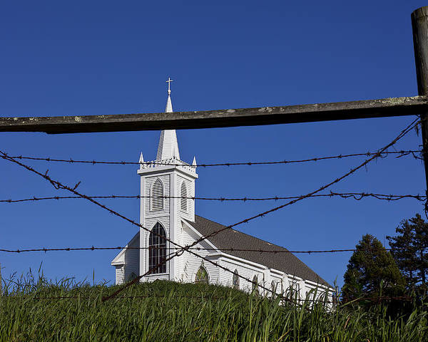Church St. Teresa's Of Avila Poster featuring the photograph Church And Barbed Wire by Garry Gay