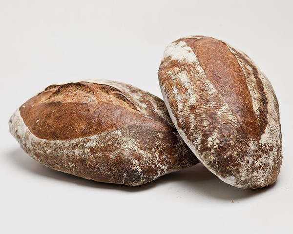 Horizontal Poster featuring the photograph Close Up Of Loaves Of Bread by Henn Photography
