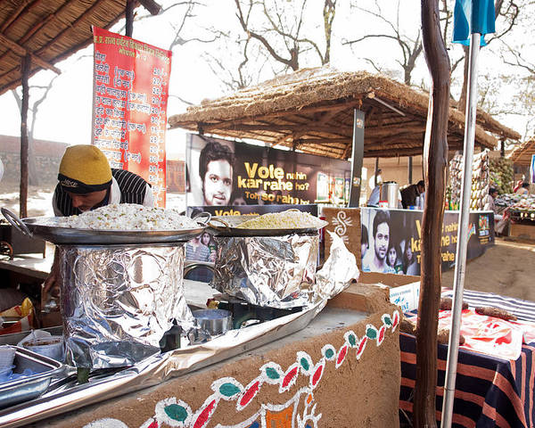 People Poster featuring the photograph Doing Vendor Duty At Food Stalls In The Surajkand Mela by Ashish Agarwal