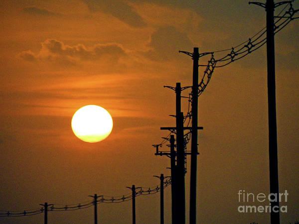 Sun Poster featuring the photograph Dusk With Poles by Joe Jake Pratt
