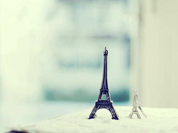 Horizontal Poster featuring the photograph Eiffel Tower Still Life With Blurry Blue Backgroun by Kristy Campbell