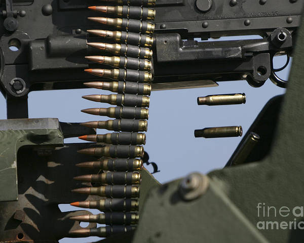 Horizontal Poster featuring the photograph Expended Brass Falls From A Machine Gun by Stocktrek Images