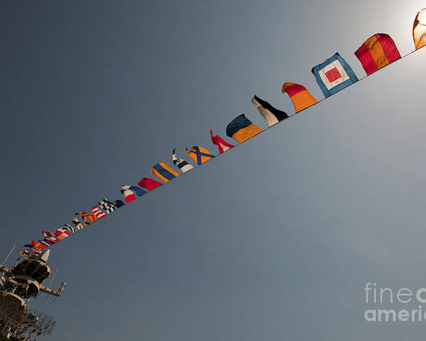 Marines Poster featuring the photograph Flags Fly Over The Deck Of The Uss Iwo by Stocktrek Images