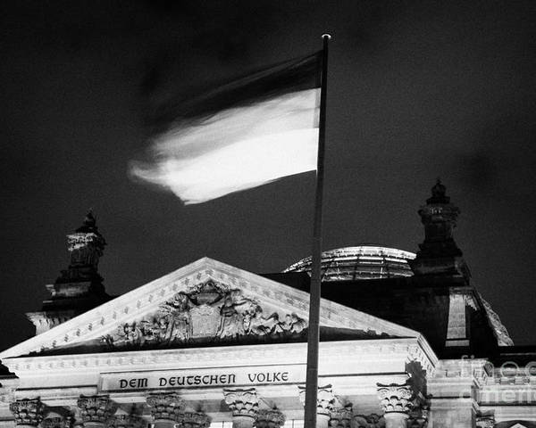 Berlin Poster featuring the photograph german flag flying fluttering on flagpole outside reichstag building Berlin Germany by Joe Fox