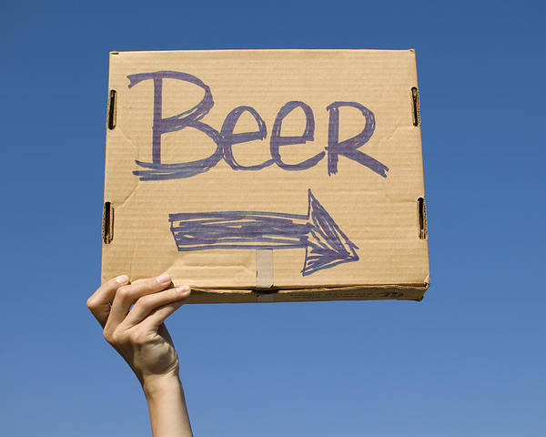 18-19 Years Poster featuring the photograph Hand Holding Up Makeshift 'beer' Sign by Pete Starman