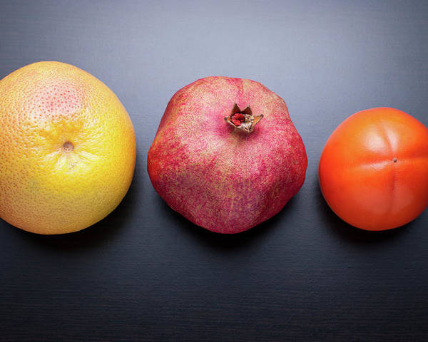 Horizontal Poster featuring the photograph Healthy Fruits On Dark Wooden Background by daitoZen