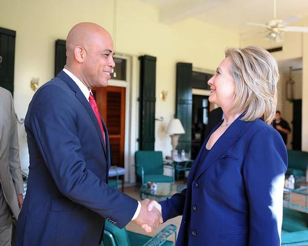 History Poster featuring the photograph Hillary Clinton Meets With Haitian by Everett