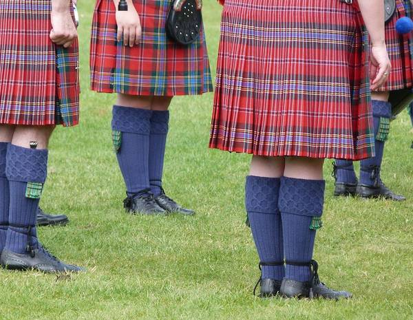 The Kilt Is Worn In Scotland As Part Of Traditional Highland Dress. These Ones Are Worn By Members Of A Pipe Band. Poster featuring the photograph Kilts by Jennifer Watson