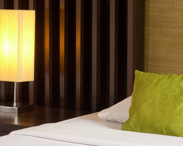 Hotel Poster featuring the photograph Lamp And Bed by Atiketta Sangasaeng