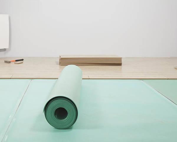 Nobody Poster featuring the photograph Laying A Floor. A Roll Of Underlay Or by Magomed Magomedagaev