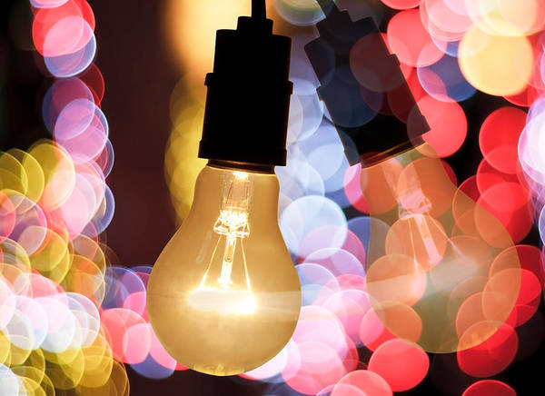 Blur Poster featuring the photograph Light Bulb And Bokeh by Setsiri Silapasuwanchai