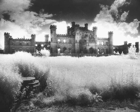 Castellated; Crenellated; Towers; Exterior; Architecture; English; Facade; Gothic; Ghostly; Atmospheric; Striking; Dramatic; Landscape; Eerie; Mysterious; Sinister Poster featuring the photograph Lowther Castle by Simon Marsden