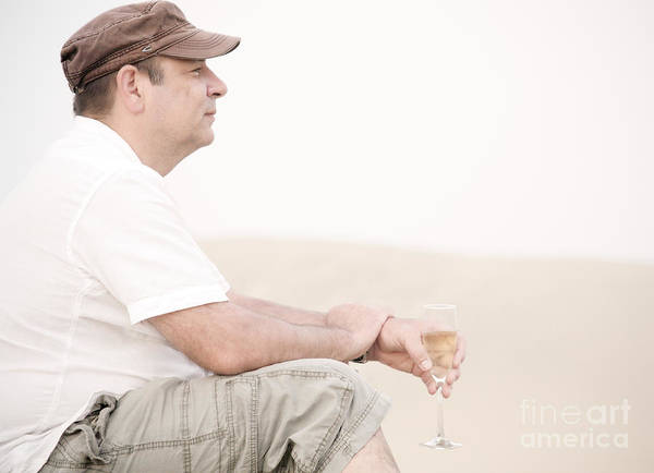 Man Poster featuring the photograph Man With Glass Of Champagner In The Dunes by Iryna Shpulak