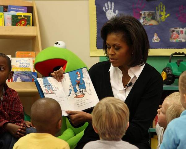 History Poster featuring the photograph Michelle Obama Reads The Cat In The Hat by Everett
