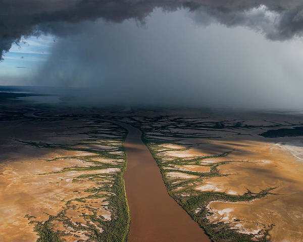 Outdoors Poster featuring the photograph Monsoon Rains Over A Muddy River by Randy Olson