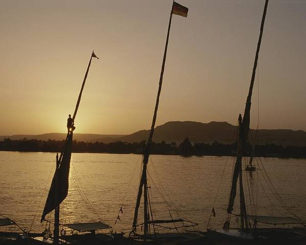 Boats Poster featuring the photograph Moored Feluccas On The Nile River by Kenneth Garrett