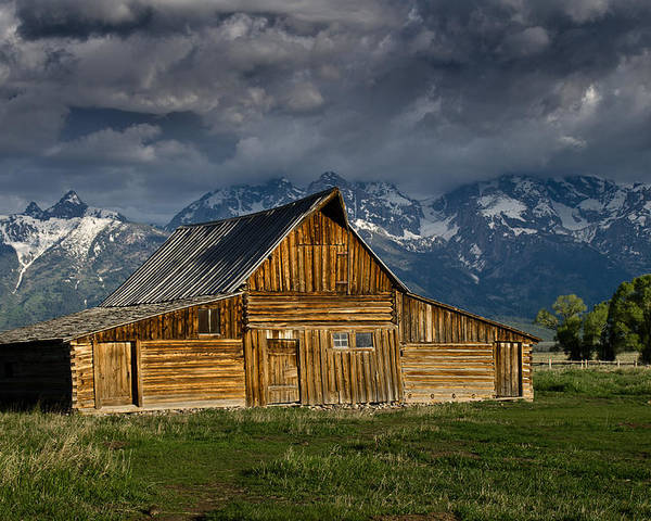 Grand Tetons Poster featuring the photograph Mormon Barn Under Approaching Storm by Greg Nyquist