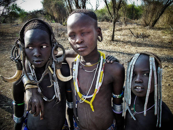 Mursi Tribal Boys In Omo Valley Poster featuring the photograph Mursi Boys by Nichon Thorstrom
