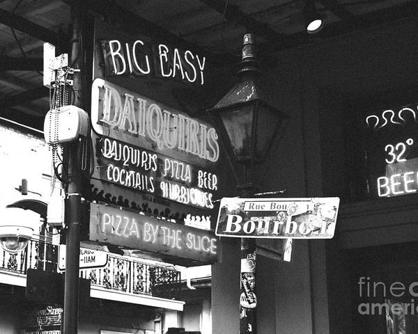 Travelpixpro New Orleans Poster featuring the photograph Neon Sign On Bourbon Street Corner French Quarter New Orleans Black And White Film Grain Digital Art by Shawn O'Brien