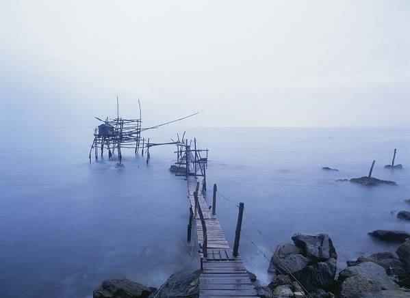 Water Poster featuring the photograph Old Fishing Platform At Dusk by Axiom Photographic