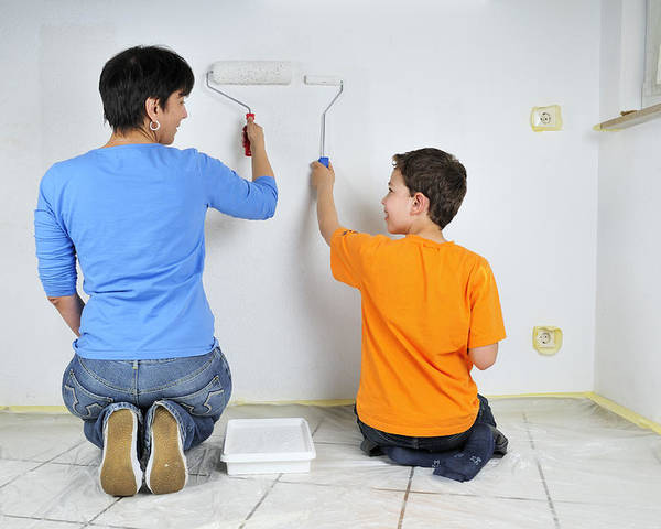 Teamwork Poster featuring the photograph Paintwork - Mother And Son Painting Wall Together by Matthias Hauser