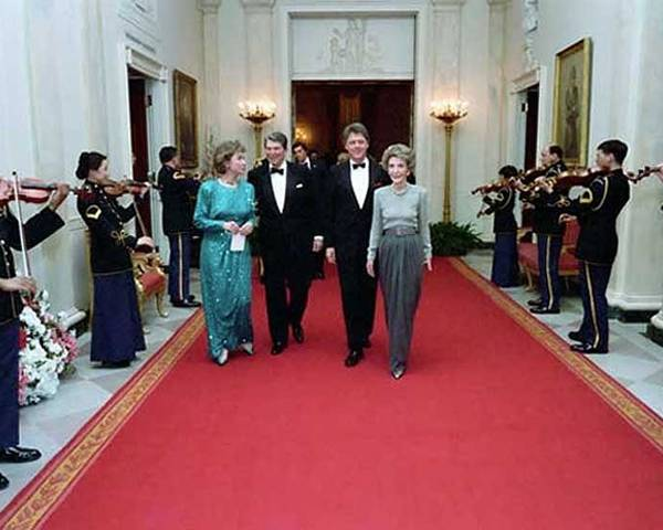 History Poster featuring the photograph President And Nancy Reagan Walking by Everett