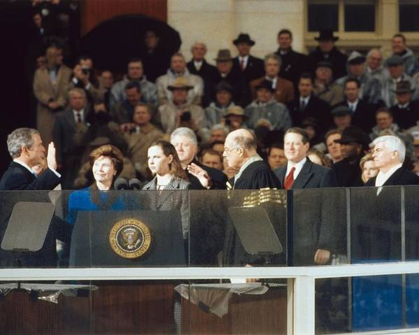History Poster featuring the photograph President-elect George W. Bush Is Sworn by Everett