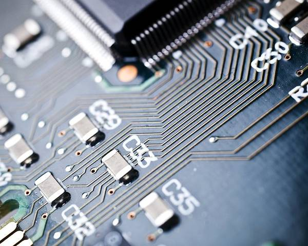Circuit Board Poster featuring the photograph Printed Circuit Board Components by Arno Massee