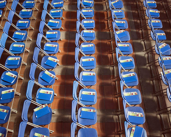 Empty Poster featuring the photograph Programs On Rows Of Seating by Marlene Ford