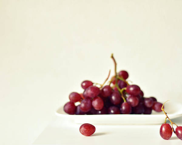 Horizontal Poster featuring the photograph Red Grapes On White Plate by Photo by Ira Heuvelman-Dobrolyubova