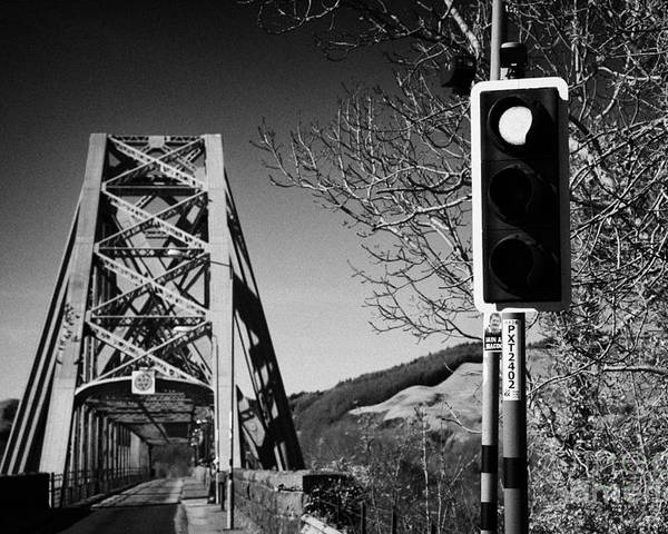 A828 Poster featuring the photograph Red Light Traffic Control At The Single Track Connel Bridge On The A828 Coastal Route Road Over Loch by Joe Fox