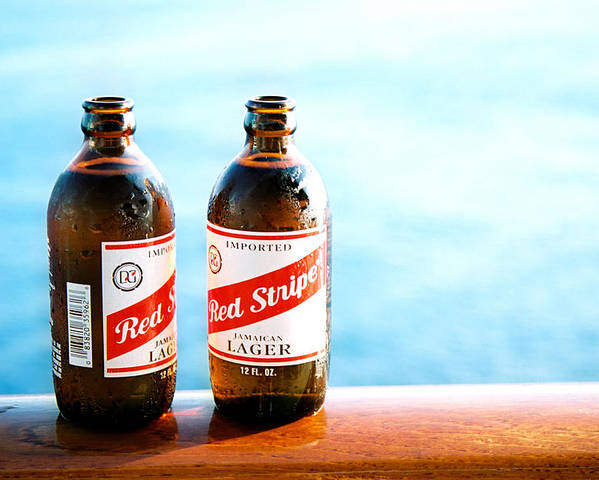 Beer Poster featuring the photograph Red Stripe by Claude Taylor