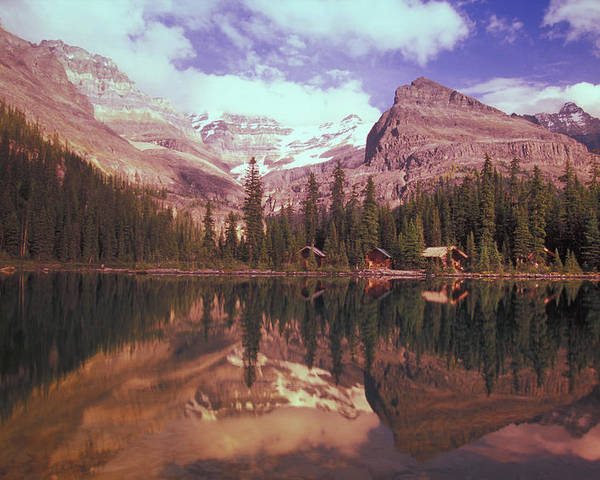 Beauty In Nature Poster featuring the photograph Reflection Of Cabins And Mountains In by Carson Ganci