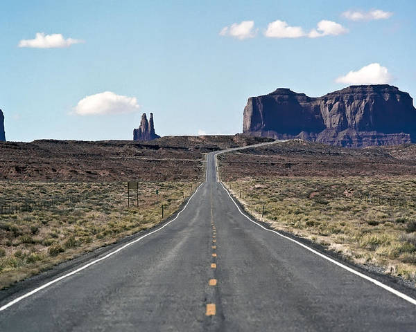 Road Poster featuring the photograph Road To Monument Valley by Luc Novovitch