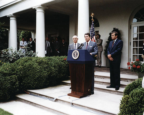 1980s Poster featuring the photograph Ronald Reagan. President Reagan Making by Everett
