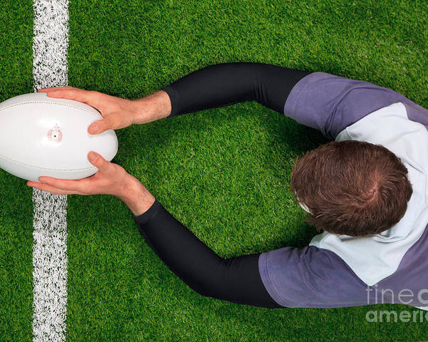 Rugby Poster featuring the photograph Rugby Player Scoring A Try With Both Hands. by Richard Thomas