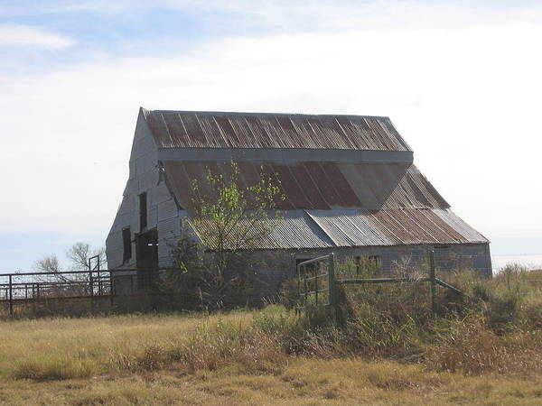 Poster featuring the photograph Rusted Barn by Amy Hosp