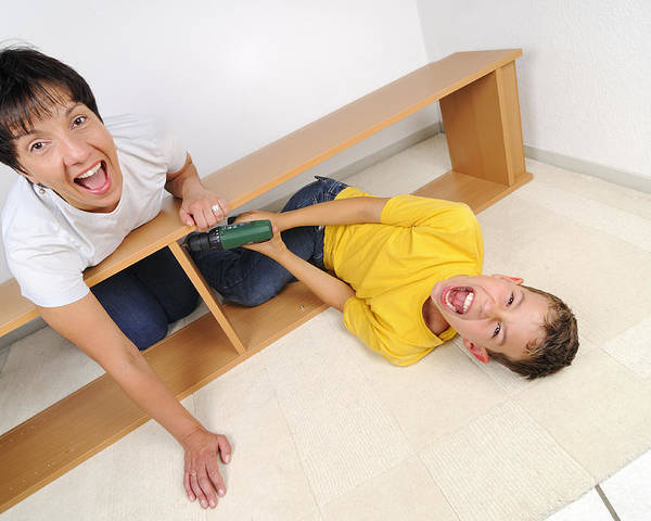 People Poster featuring the photograph Screaming Mother And Son Assembling Furniture by Matthias Hauser