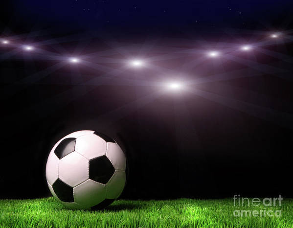 Abstract Poster featuring the photograph Soccer Ball On Grass Against Black by Sandra Cunningham