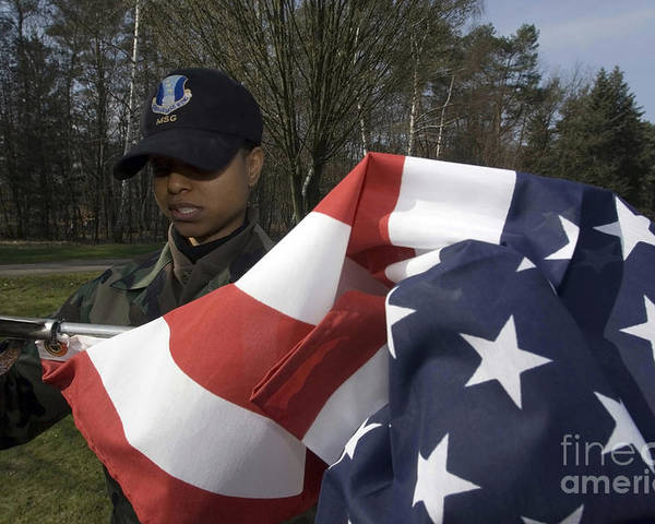 Horizontal Poster featuring the photograph Soldier Unfurls A New Flag For Posting by Stocktrek Images