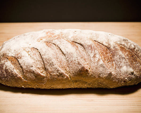 Horizontal Poster featuring the photograph Studio Shot Of Loaf Of Bread by Kristin Lee
