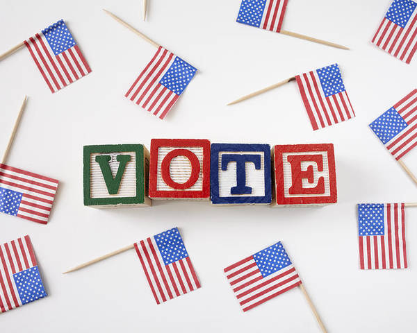 Horizontal Poster featuring the photograph Studio Shot Of Small American Flags And Wooden Blocks With Text Vote by Winslow Productions