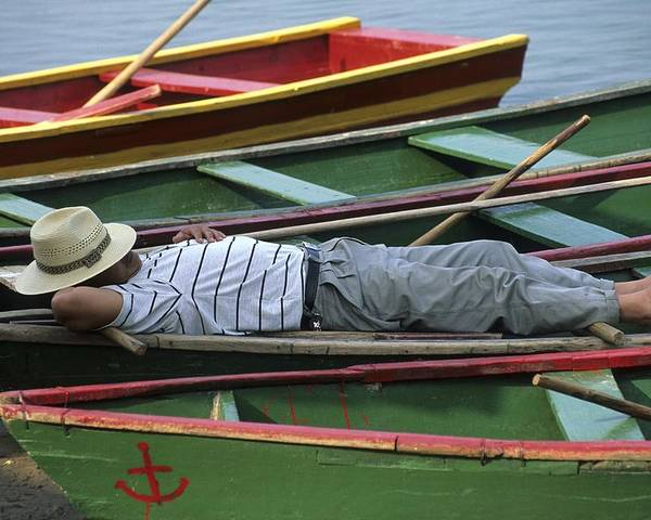 Outdoors Poster featuring the photograph Tour Boat Guide Naps Amidst Rowboats by Raymond Gehman
