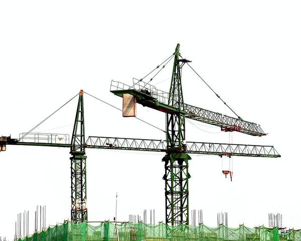 Construction Poster featuring the photograph Two Cranes On A Construction Site by Yali Shi