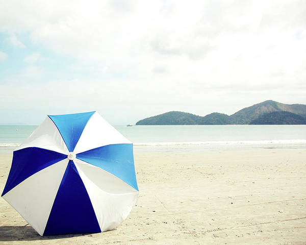 Horizontal Poster featuring the photograph Umbrella On Sand by Grace Oda